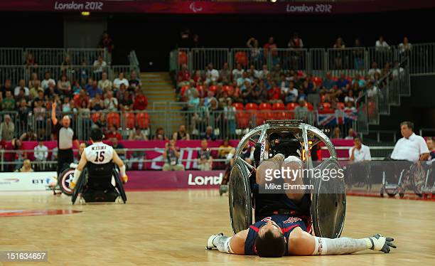 Chuck Aoki of the United States tips over during the Bronze Medal match of Mixed Wheelchair Rugby against Japan on day 11 of the London 2012...
