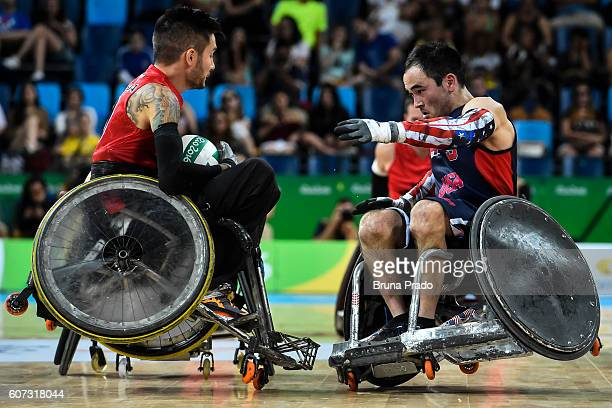 Chuck Aoki of United States and Trevor Hirschfeild of Canada compete during the Wheelchair Rugby SemiFinal match between United States and Canada at...