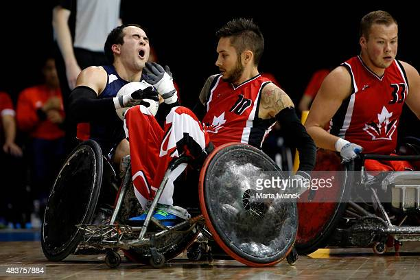 AUGUST 12 Chuck Aoki of USA and Trevor Hirschfield of Canada collide during the Wheelchair Rugby game between Canada and the USA during the 2015...