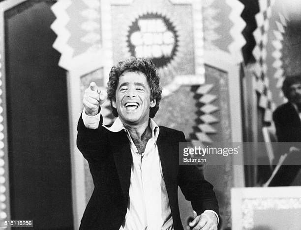 Chuck Barris the maniacal hostproducer of 'The Gong Show' and producer of '$198 Beauty Show' reacts during a taping session of one of his Gong shows...