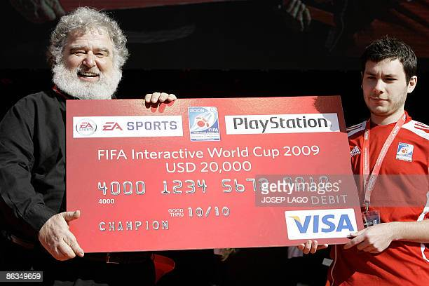 Chuck Blazer member of the FIFA comitee delivers a check to French Bruce Grannec winner of the Fifa Interactive World Cup Grand Final 2009 against...