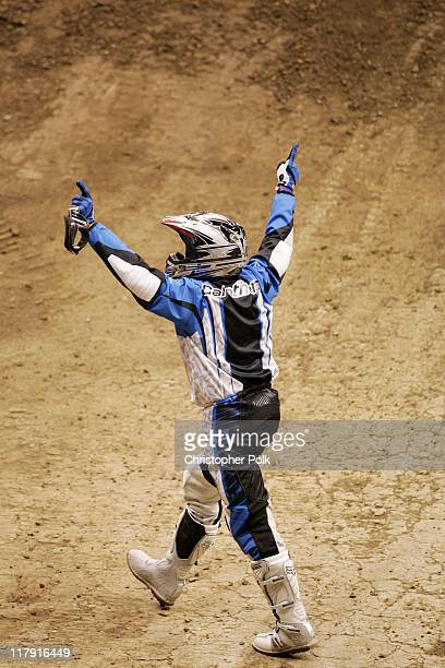 Chuck Carothers celebrates after performing a never seen before trick during the X Games Moto X Big Air Finals at Staples Center in Los Angeles on...