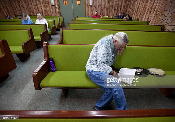 Chuck Conner reads the Bible during a service at the Church of the Lord Jesus a Pentecostal 'Signs Following' church in Jolo West Va on Sept 2 2011...