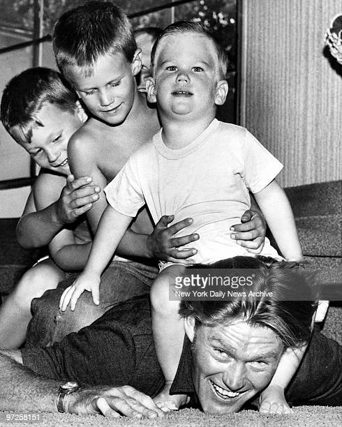 Chuck Connors is practicing for his cowboy role in TV show The Rifleman Baseball playerturnedactor is makebelieve horse for his sons Steve Mike Jeff...