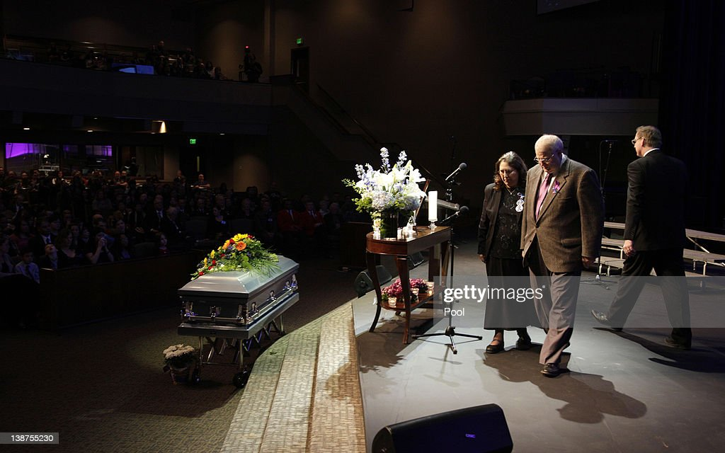 Chuck Cox and his wife Judy Cox walk past the casket bearing