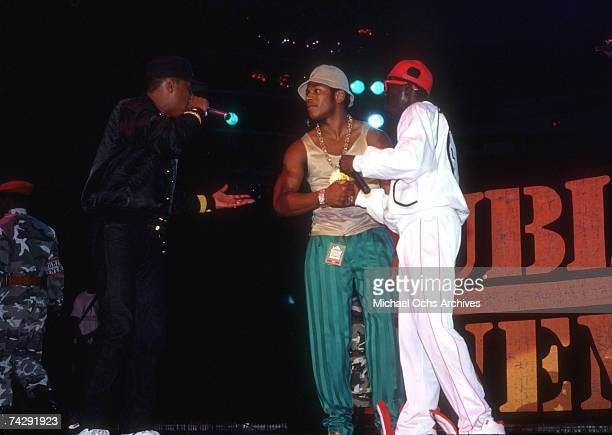 Chuck D and Flavor Flav of the rap group 'Public Enemy' are joined onstage by rapper LL Cool J in August 1988