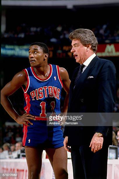 Chuck Daly head coach of the Detroit Pistons has a few words with Isiah Thomas during a break in the action against the Los Angeles Lakers during a...