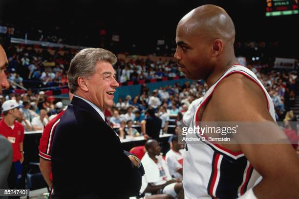 Chuck Daly head coach of the United States Men's Basketball team talks with Charles Barkley during a game played at the 1992 Olympics in Barcelona...