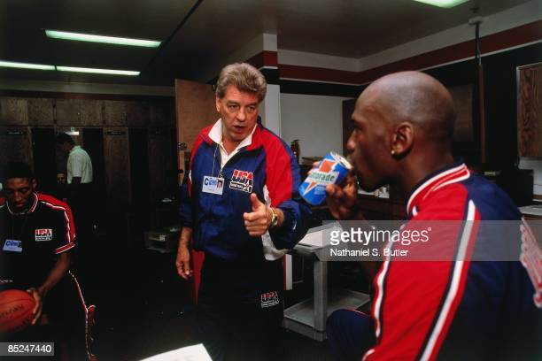 Chuck Daly, head coach of the United States talks with Michael Jordan prior to a game during the 1992 Olympics played in Barcelona, Spain. NOTE TO...