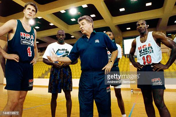 Chuck Daly of the United States National Team talks to his team during a practice in June 1992 in La Jolla California NOTE TO USER User expressly...
