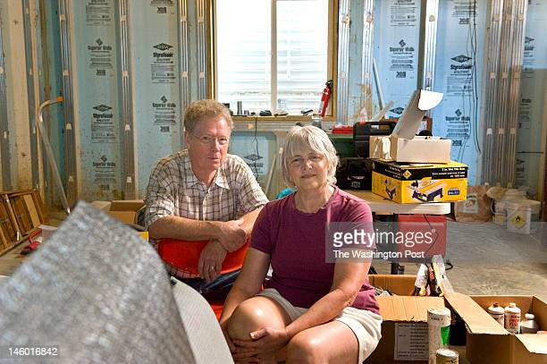 Chuck Dulaney and Donna Olsen pose in their roughed out basement Monday June 2012 in Kensington MD Dulaney and Olsen planned from the beginning to...