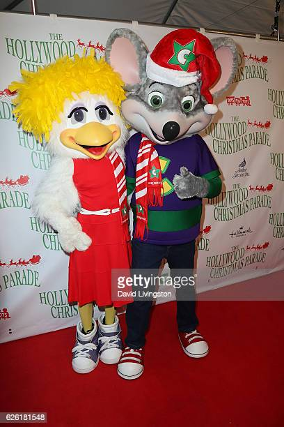 Chuck E Cheese and Helen Henny arrive at the 85th Annual Hollywood Christmas Parade on November 27 2016 in Hollywood California