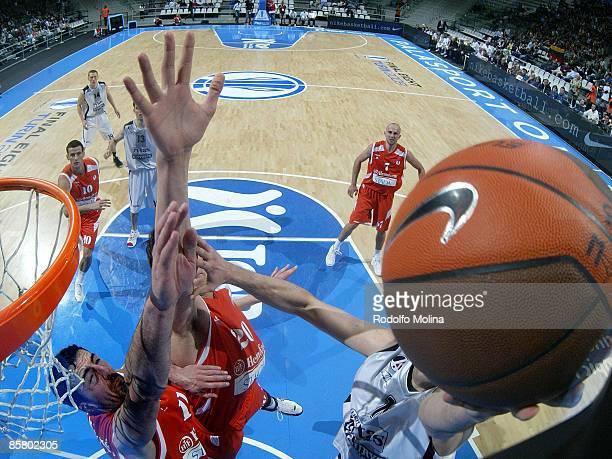Chuck Eidson, #13 of Lietuvos Rytas competes with Boban Marjanovic, #20 of Hemofarm Stada and Bojan Krstovic, #11 Eurocup Basketball Semi Final 1,...