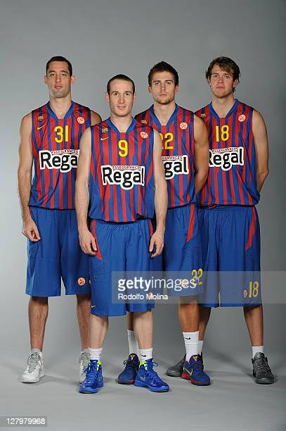 Chuck Eidson #31 Marcelinho Huertas #9 Xavi Rabaseda #22 and Charles Wallace #18 pose during the FC Barcelona Regal 2011/2012 Turkish Airlines...