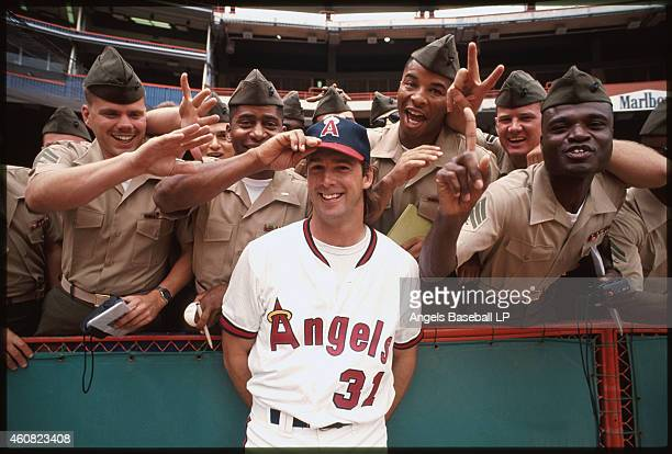 Chuck Finley of the California Angels stands with military personal before a game at Anaheim Stadium in Anaheim California Chuck Finley played for...
