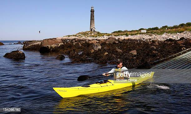 Chuck Fischer of Montclair, N J  starts paddling back to the