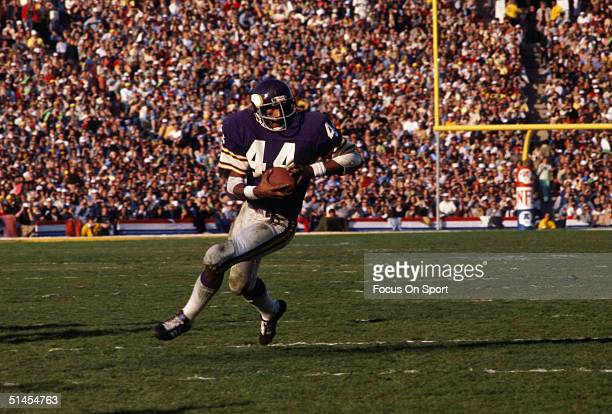 Chuck Foreman of the Minnesota Vikings runs with the ball during Super Bowl XI against the Oakland Raiders at the Rose Bowl on January 9 1977 in...