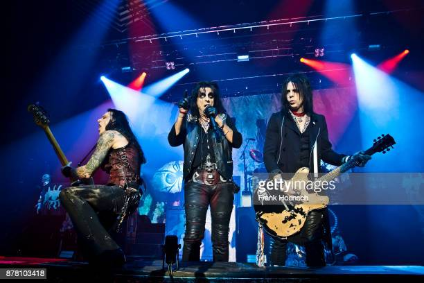 Chuck Garric Alice Cooper and Tommy Henriksen perform live on stage during a concert at the Tempodrom on November 23 2017 in Berlin Germany