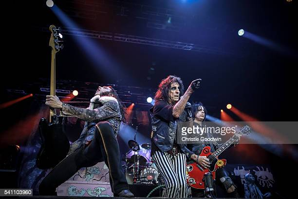 Chuck Garric Alice Cooper and Tommy Henriksenr perform on stage at The O2 Arena on June 18 2016 in London England