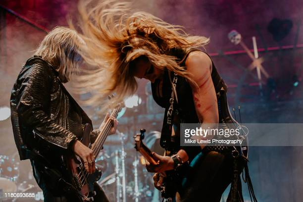 Chuck Garric and Nita Strauss perform on stage with Alice Cooper at Motorpoint Arena on October 12, 2019 in Cardiff, Wales.
