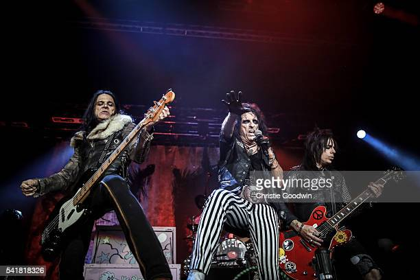 Chuck Garrick Alice Cooper and Tommy Henriksen perform on stage at The O2 Arena on June 18 2016 in London England