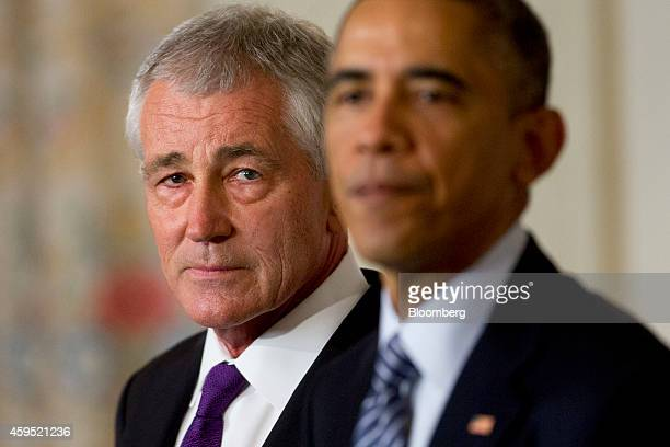 Chuck Hagel US secretary of defense left listens as US President Barack Obama speaks in the State Dining Room of the White House in Washington DC US...