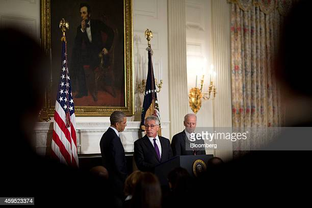 Chuck Hagel US secretary of defense speaks in the State Dining Room of the White House with US President Barack Obama left and US Vice President...