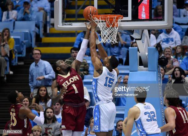 Chuck Hannah of the Elon Phoenix battles Garrison Brooks of the North Carolina Tar Heels for a rebound during the first half of their game at the...