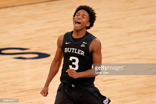 Chuck Harris of the Butler Bulldogs celebrates against the Xavier Musketeers during the first overtime of their first round game of the Big East...