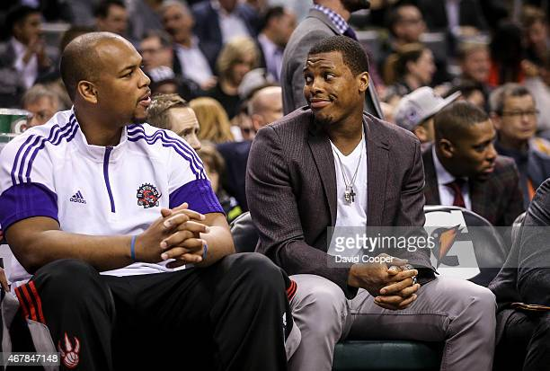 TORONTO ON MARCH 27 Chuck Hayes and Kyle Lowry of the Toronto Raptors talk on the bench during the game between the Toronto Raptors and the Los...