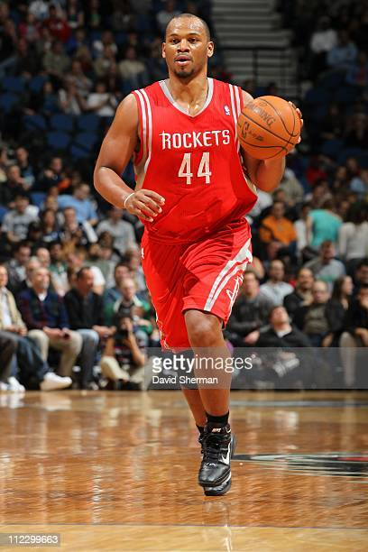 Chuck Hayes of the Houston Rockets dribbles the ball against the Minnesota Timberwolves during a game on April 13 2011 at Target Center in...