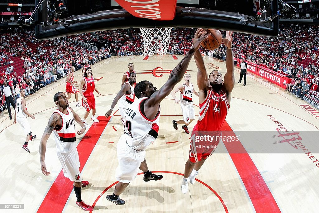 Chuck Hayes #44 of the Houston Rockets goes to the basket against Martell Webster #23 of the Portland Trail Blazers during the game on October 31, 2009 at the Toyota Center in Houston, Texas. The Rockets won 111-107.
