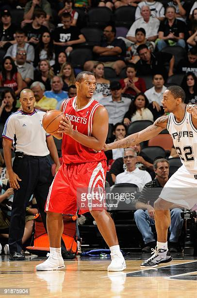 Chuck Hayes of the Houston Rockets handles the ball against Marcus Haislip of the San Antonio Spurs during the preseason game on October 6 2009 at...