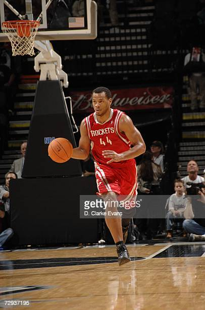 Chuck Hayes of the Houston Rockets moves the ball against the San Antonio Spurs during the game at the ATT Center on December 22 2006 in San Antonio...