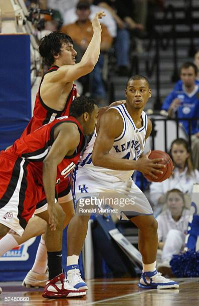 Chuck Hayes of the Kentucky Wildcats handles the ball under pressure from Andrew Bogut of the Utah Utes during the 2005 NCAA division 1 men's...