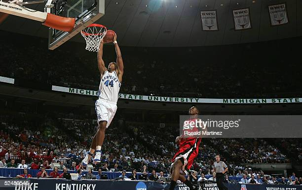 Chuck Hayes of the Kentucky Wildcats slam dunks the ball past Justin Hawkins of the Utah Utes during the 2005 NCAA division 1 men's basketball...