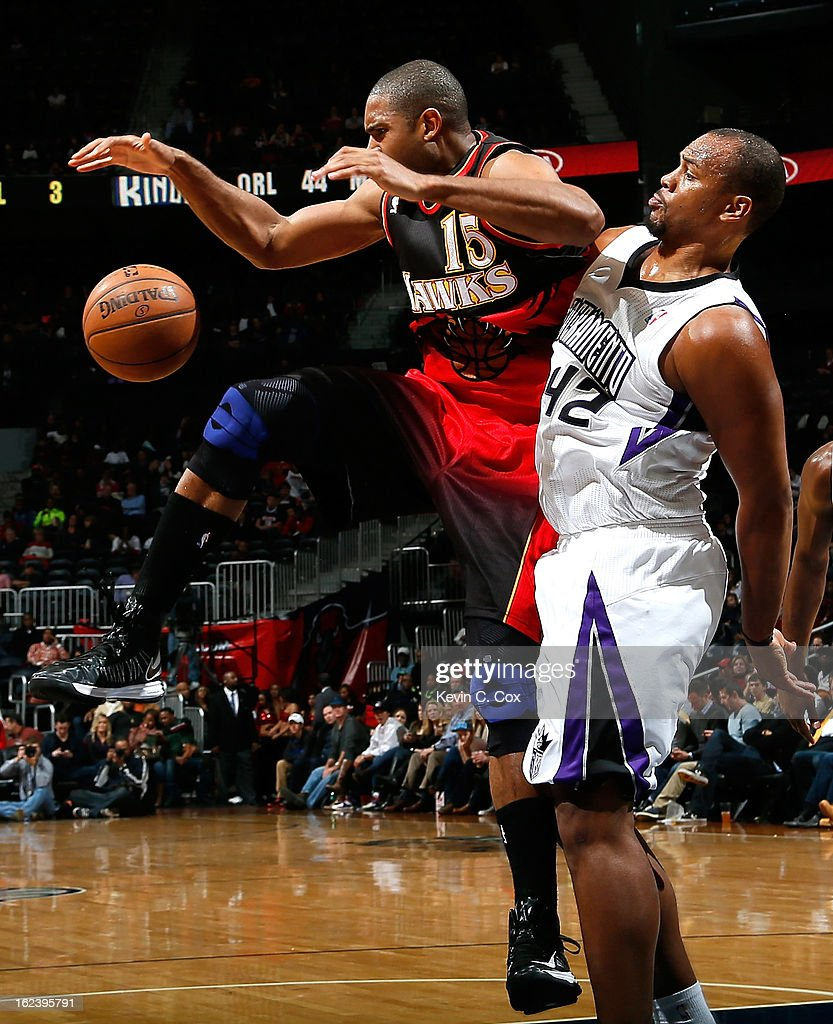 Chuck Hayes #42 of the Sacramento Kings fouls Al Horford #15 of the Atlanta Hawks at Philips Arena on February 22, 2013 in Atlanta, Georgia.