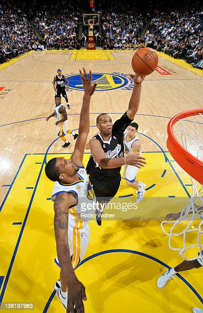 Chuck Hayes of the Sacramento Kings shoots the ball over the outstretched arms of Dominic McGuire of the Golden State Warriors on January 31 2012 at...