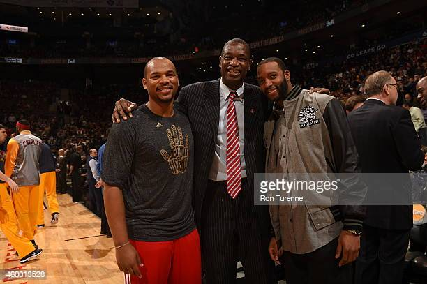 Chuck Hayes of the Toronto Raptors Dikembe Mutombo and Tracy McGrady before the game between the Toronto Raptors and the Cleveland Cavaliers on...