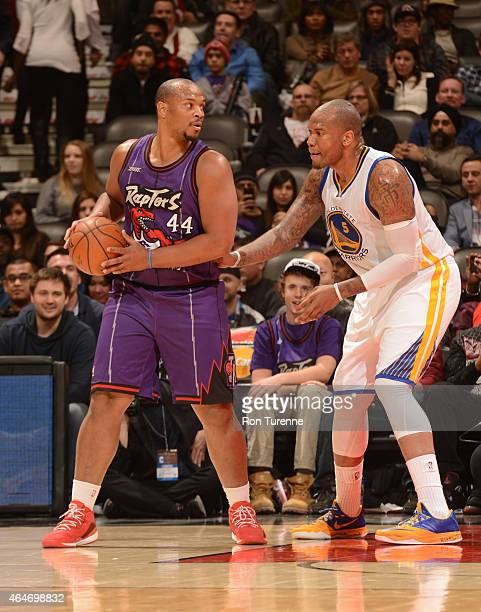 Chuck Hayes of the Toronto Raptors handles the ball against Marreese Speights of the Golden State Warriors on February 27 2015 at the Air Canada...