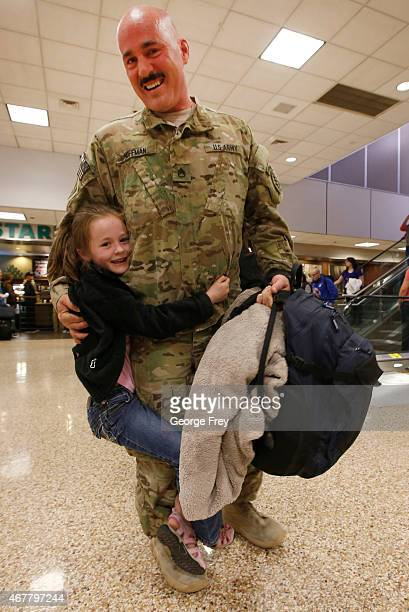 SSG Chuck Hoffman gets a hug from his daughter Mikaela as he and members of the Utah National Guard's 19th Special Forces Airborne unit return from...