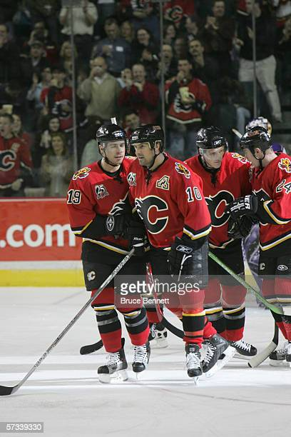 Chuck Kobasew and Tony Amonte of the Calgary Flames celebrate on the ice during the game against the Los Angeles Kings on March 29 2006 at the...