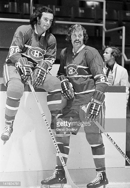 Chuck Lefley and Steve Shutt of the Montreal Canadiens talk during warmups before a game Circa 1970 at the Montreal Forum in Montreal Quebec Canada