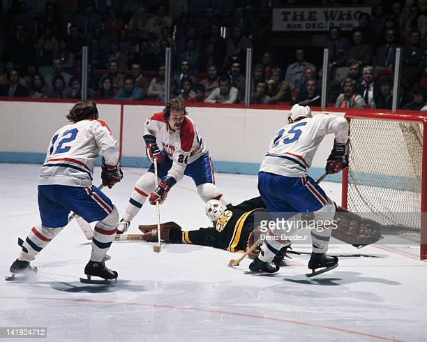Chuck Lefley Jaques Lemaire and Yvan Couroyer of the Montreal Canadiens all look for a rebound near the Boston Bruins net Circa 1970 at the Montreal...