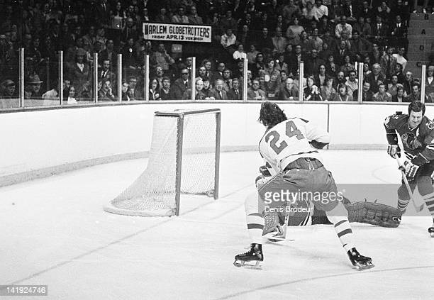 Chuck Lefley of the Montreal Canadiens attempts to score against the Chicago Blackhawks Circa 1970 at the Montreal Forum in Montreal Quebec Canada