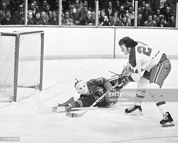 Chuck Lefley of the Montreal Canadiens attempts to score on a breakaway during a game against the Chicago Blackhawks Circa 1970 at the Montreal Forum...