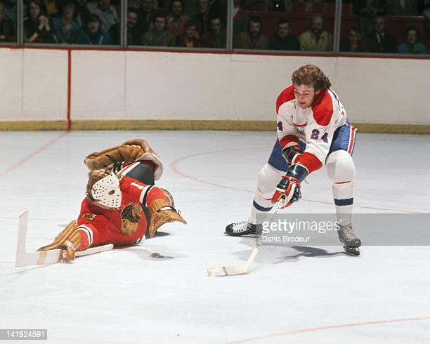 Chuck Lefley of the Montreal Canadiens attempts to score on Gary Smith of the Chicago Blackhawks Circa 1970 at the Montreal Forum in Montreal Quebec...
