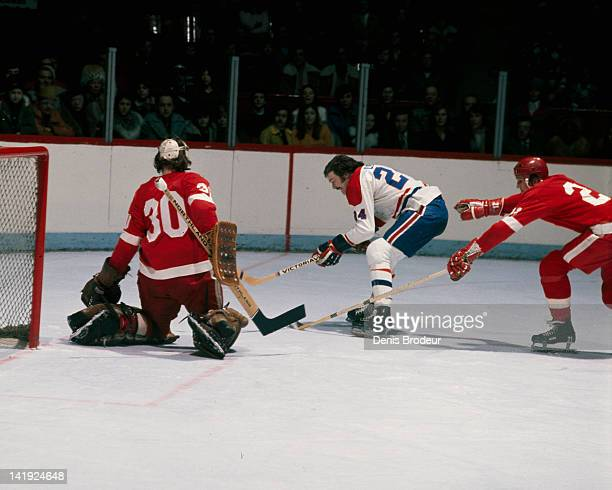 Chuck Lefley of the Montreal Canadiens backhands a shot on goal against the Detroit Red Wings Circa 1970 at the Montreal Forum in Montreal Quebec...