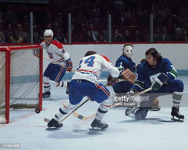 Chuck Lefley of the Montreal Canadiens scores against the Vancouver Canucks Circa 1970 at the Montreal Forum in Montreal Quebec Canada