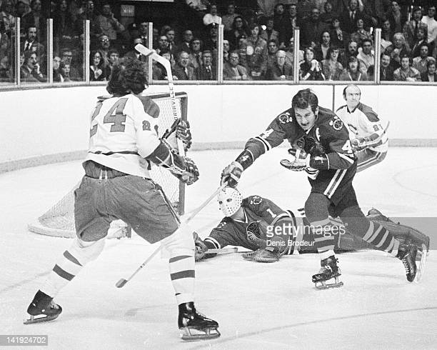 Chuck Lefley of the Montreal Canadiens shoots the puck during a game against the Chicago Blackhawks Circa 1970 at the Montreal Forum in Montreal...